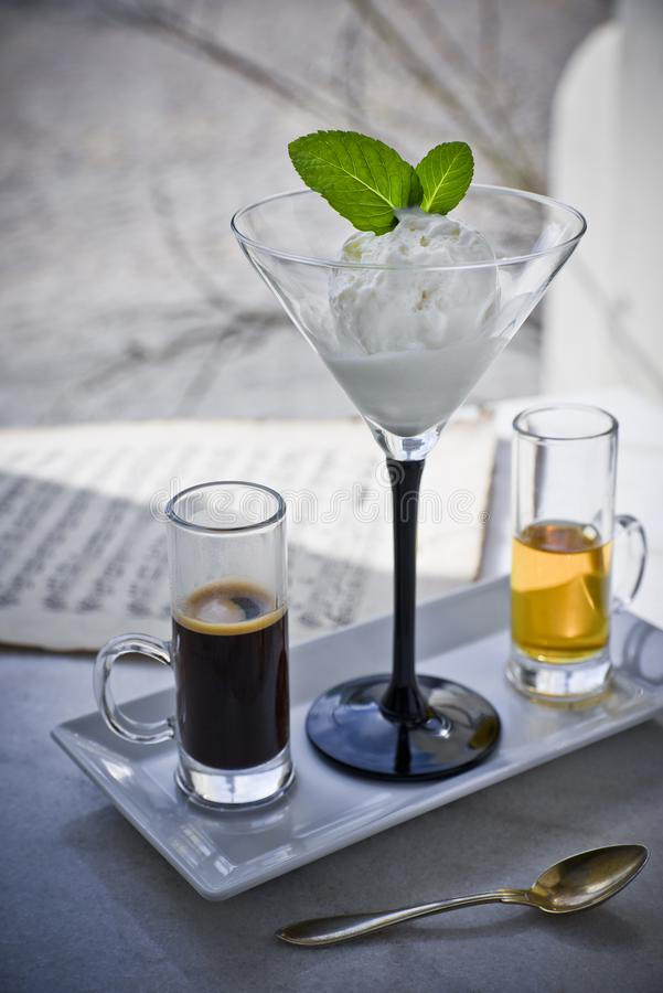 Affogato with with Ice Cream, strawberries, mint leaves, espresso and liqueur on the marble table stock photo