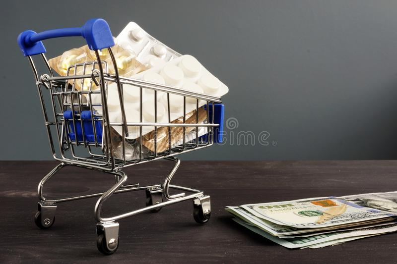 Affordable health care and insurance. Medicines in the shopping cart stock image