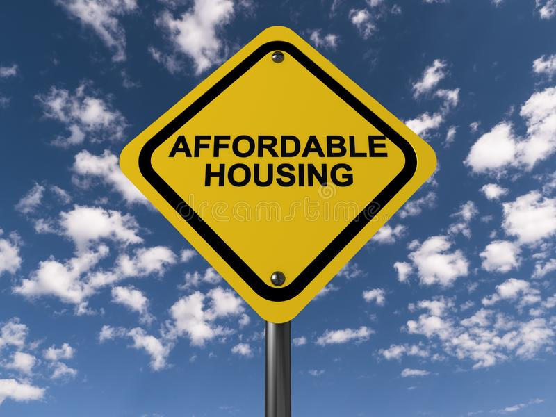 Affordable housing sign. A yellow affordable housing sign and the sky in the background royalty free stock image