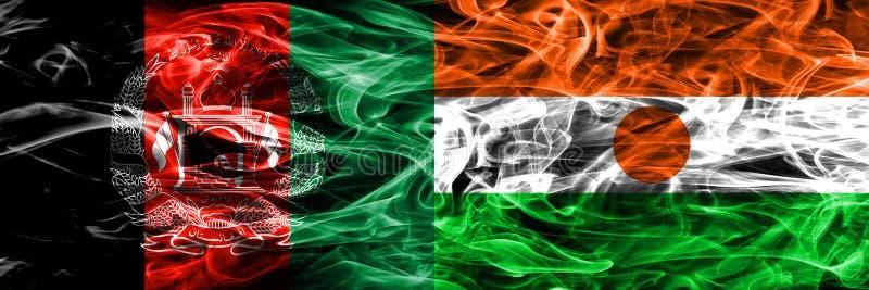Afganistan vs Niger dymu flaga umieszczająca strona strona - obok - Gęsty colo obraz stock
