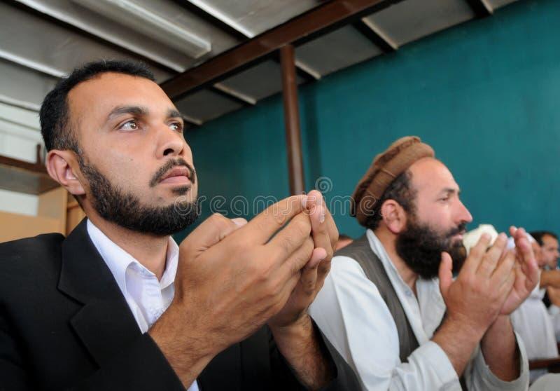 Afghan men praying stock photo