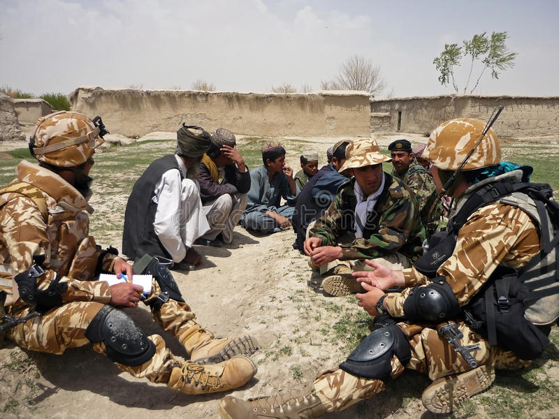 Afghan military officer interrogating locals royalty free stock photos