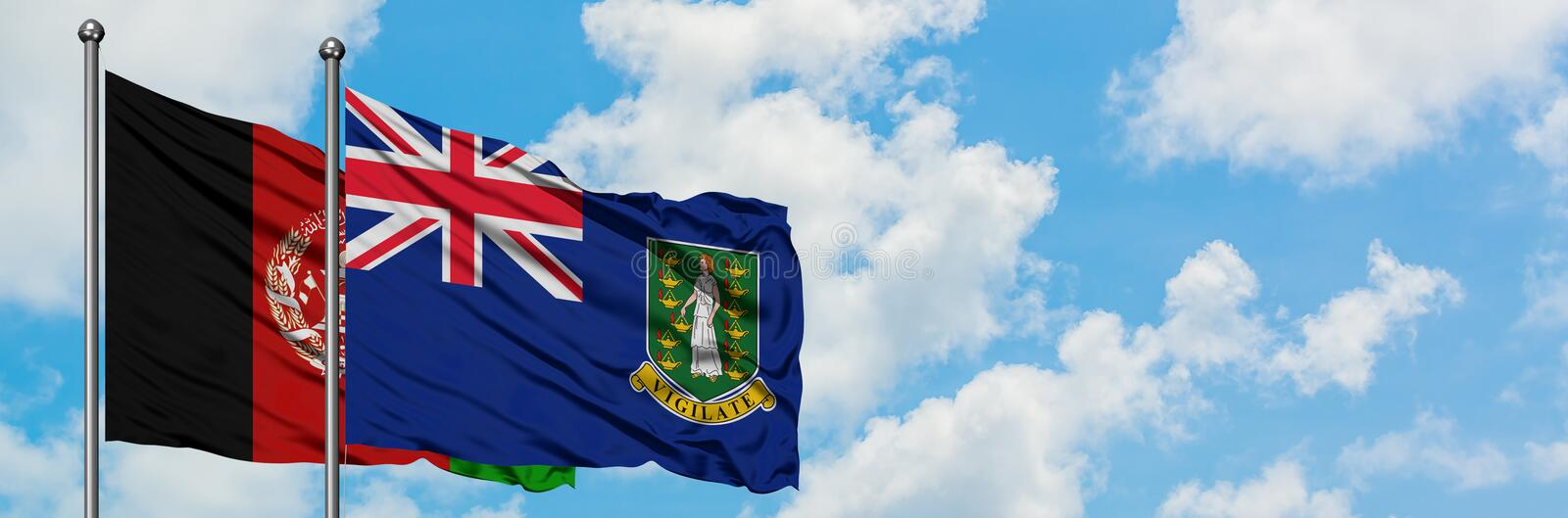 Afghanistan and British Virgin Islands flag waving in the wind against white cloudy blue sky together. Diplomacy concept,. International relations stock image