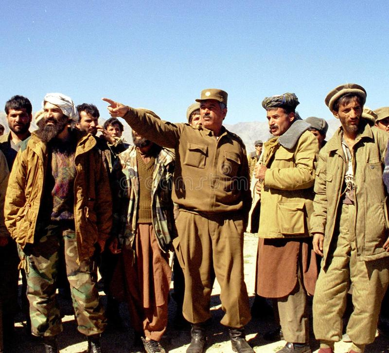 AFGHANISTAN. CHARIKAR, AFGHANISTAN, 05 OCTOBER 1997 --- Taliban opposition co-leader General Rashid Dostum, at center, gives directions to his troops during an stock photos