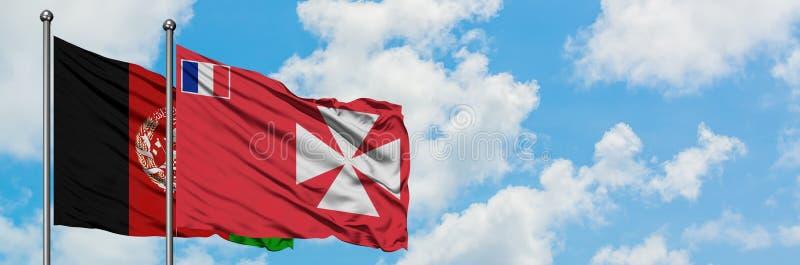 Afghanistan en Wallis And Futuna markeren samen het golven in de wind tegen witte bewolkte blauwe hemel Internationaal diplomatie royalty-vrije stock foto's