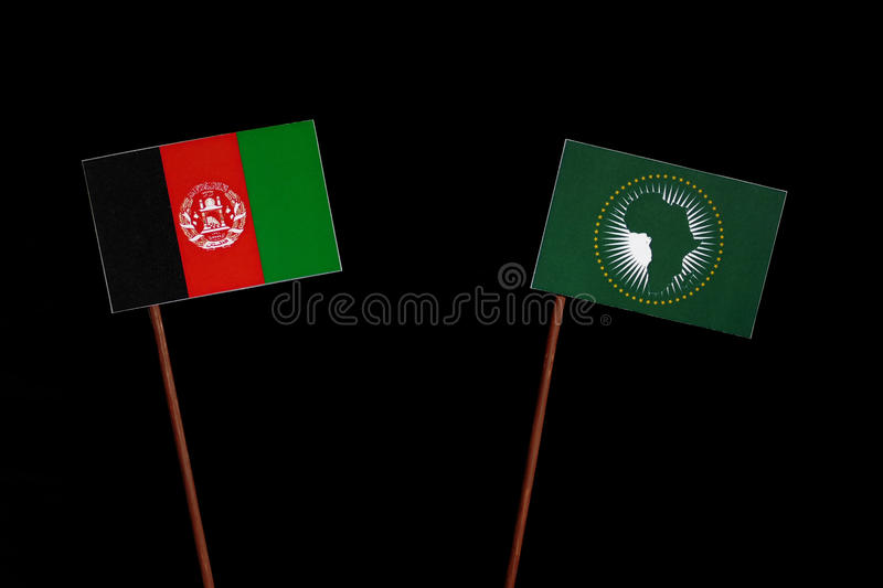 Afghanistan flag with African Union flag isolated on black royalty free stock images