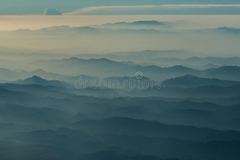 Afghanistan in the mist. High altitude view of Afghanistan in the early morning mist royalty free stock image