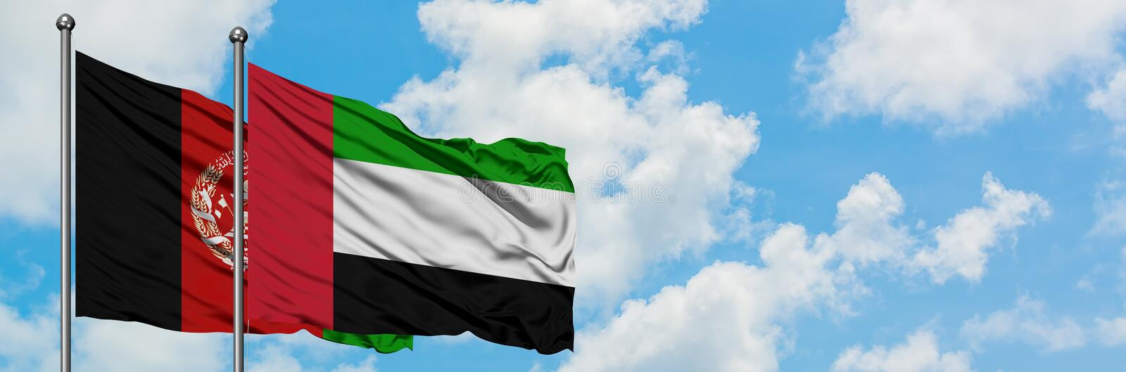 Afghanistan and United Arab Emirates flag waving in the wind against white cloudy blue sky together. Diplomacy concept,. International relations royalty free stock photo