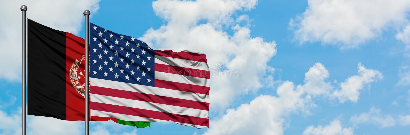 Afghanistan and United States flag waving in the wind against white cloudy blue sky together. Diplomacy concept, international. Relations stock images
