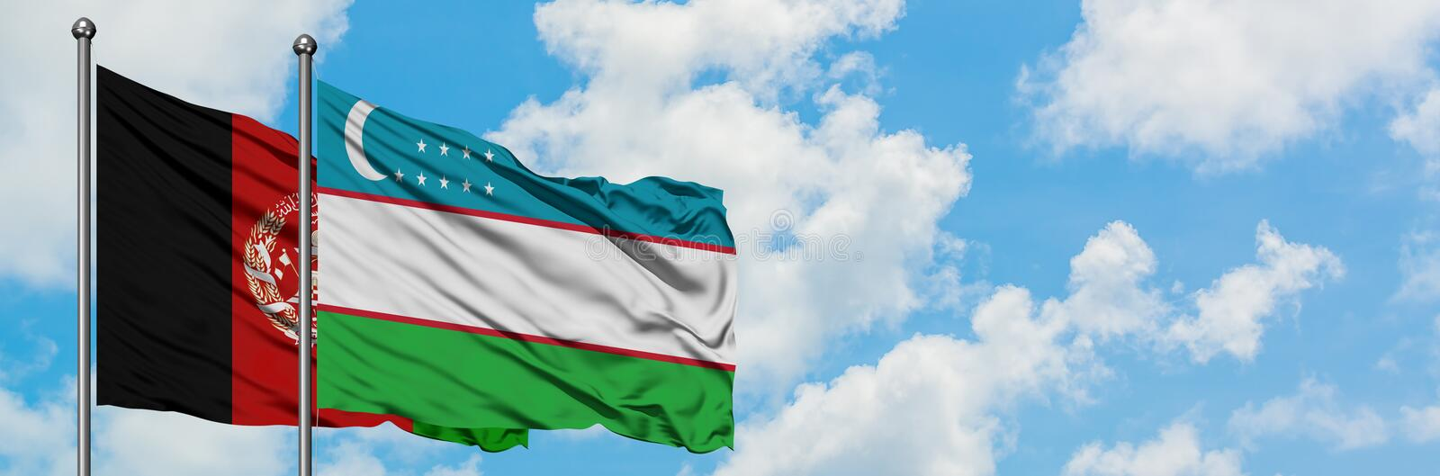 Afghanistan and Uzbekistan flag waving in the wind against white cloudy blue sky together. Diplomacy concept, international. Relations stock photography