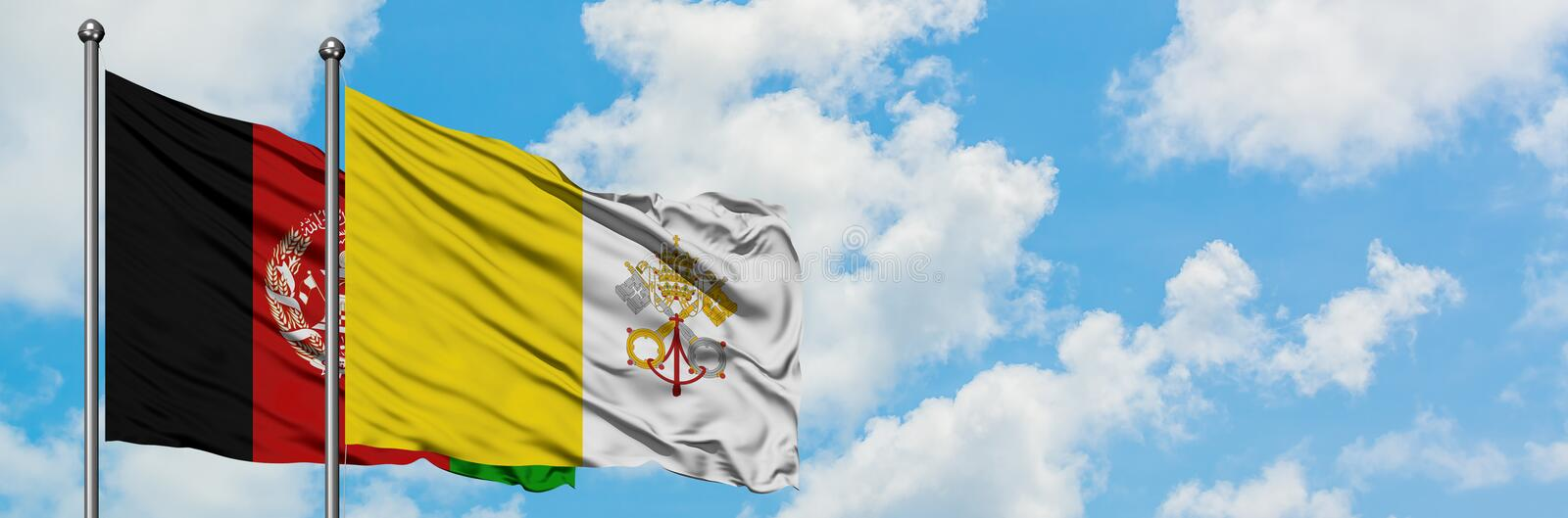 Afghanistan and Vatican City flag waving in the wind against white cloudy blue sky together. Diplomacy concept, international. Relations stock images