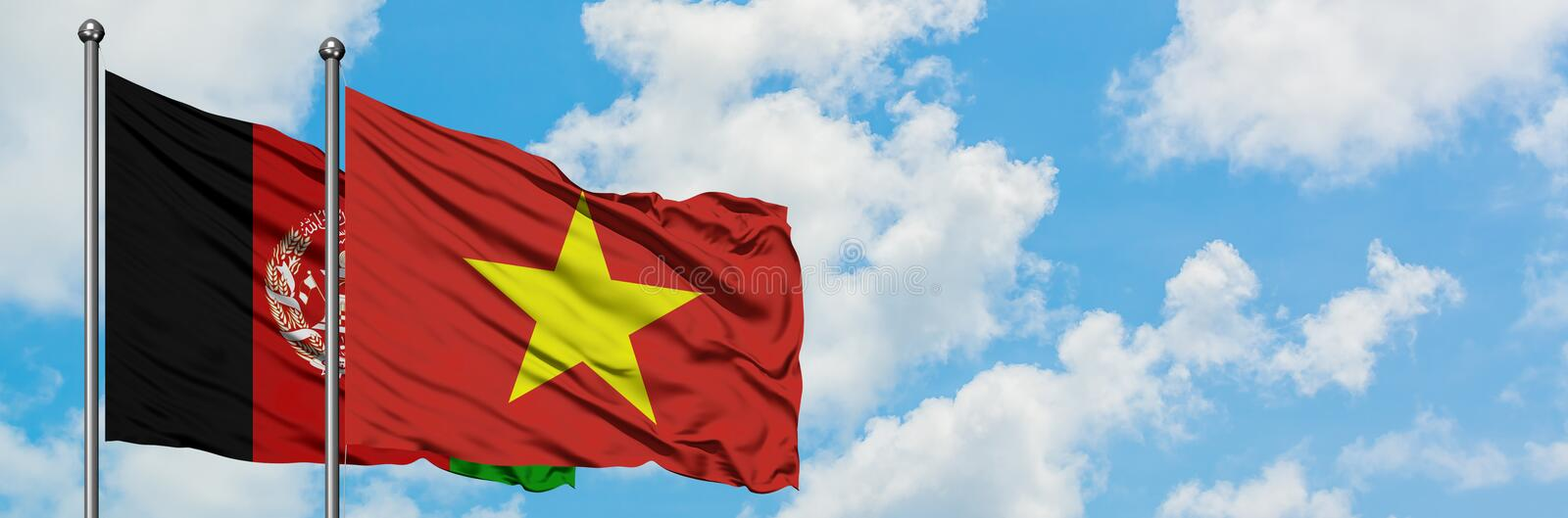Afghanistan and Vietnam flag waving in the wind against white cloudy blue sky together. Diplomacy concept, international relations.  stock images