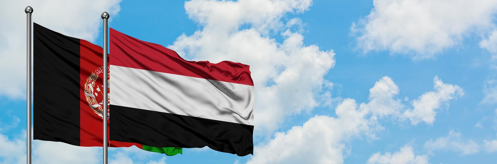 Afghanistan and Yemen flag waving in the wind against white cloudy blue sky together. Diplomacy concept, international relations.  stock images