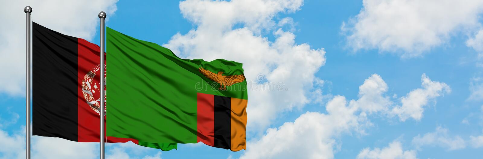 Afghanistan and Zambia flag waving in the wind against white cloudy blue sky together. Diplomacy concept, international relations.  stock photography