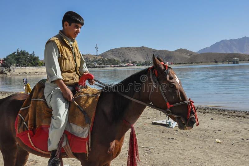 Afghansk ryttare på hästrygg fotografering för bildbyråer