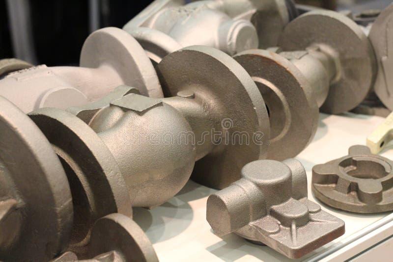 Afgietsels van gelegeerd en roestvrije stalen Gietende metalen stock afbeeldingen