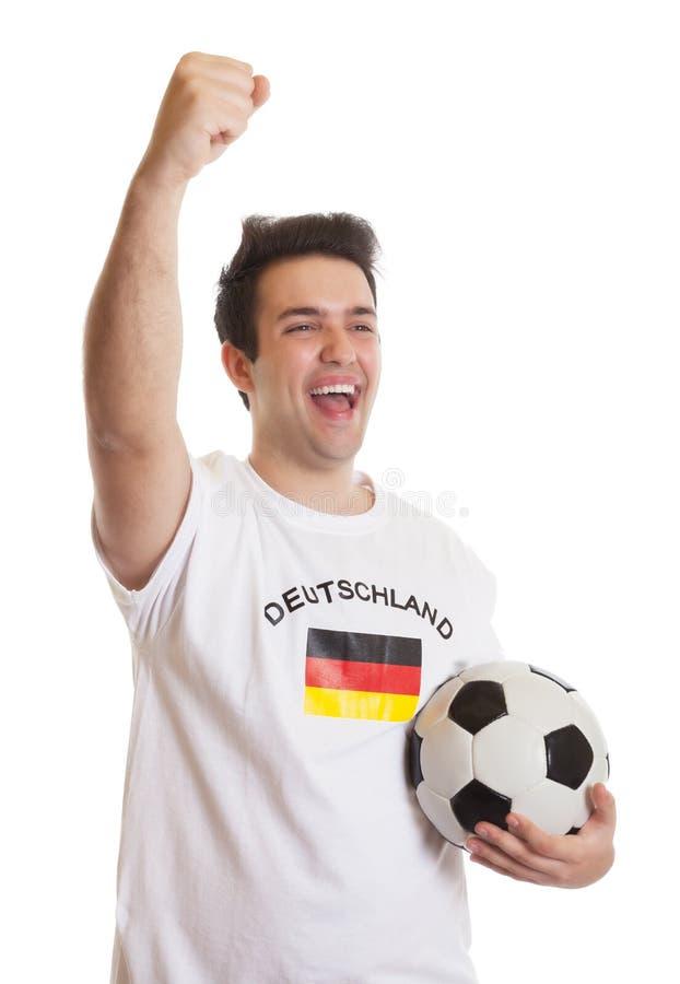 Aficionado al fútbol alemán de griterío con fútbol imagenes de archivo