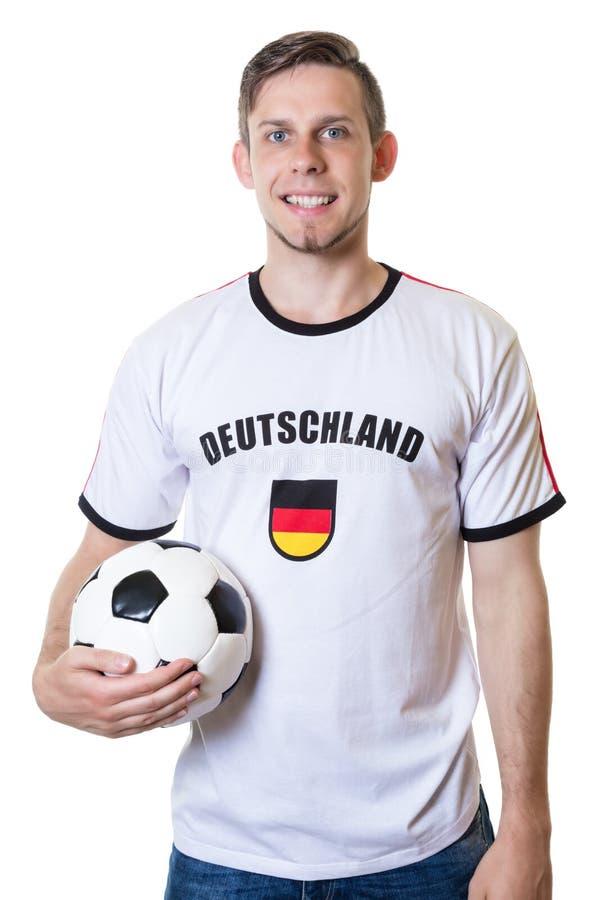Aficionado al fútbol alemán feliz con la bola imagenes de archivo