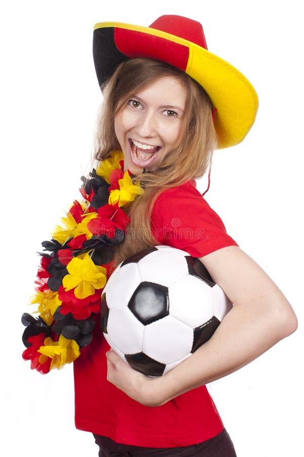 Aficionado al fútbol femenino alemán con la bola fotos de archivo libres de regalías