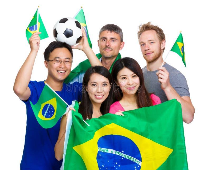Aficionados al fútbol brasileños del deporte fotos de archivo