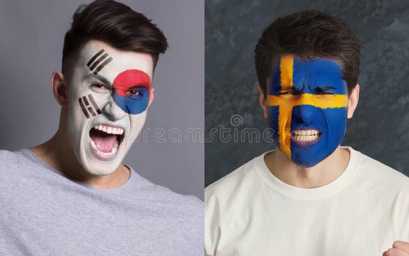Aficionados al fútbol emocionales con las banderas pintadas en caras foto de archivo
