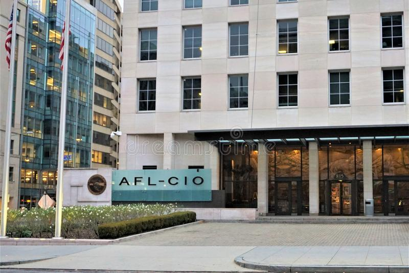 AFL CIO headquarters in Washington DC. American Federation of Labor and Congress of Industrial Organizations entryway on Winters day 2018. Raised flags on stock photo