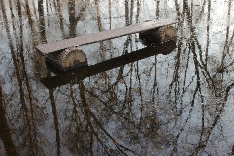 Afloat. The picture represent a bench in water. The reflection is wonderful!nCamera: Canon EOS 600D royalty free stock photos