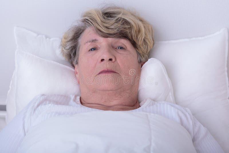 Afraid elder woman royalty free stock images