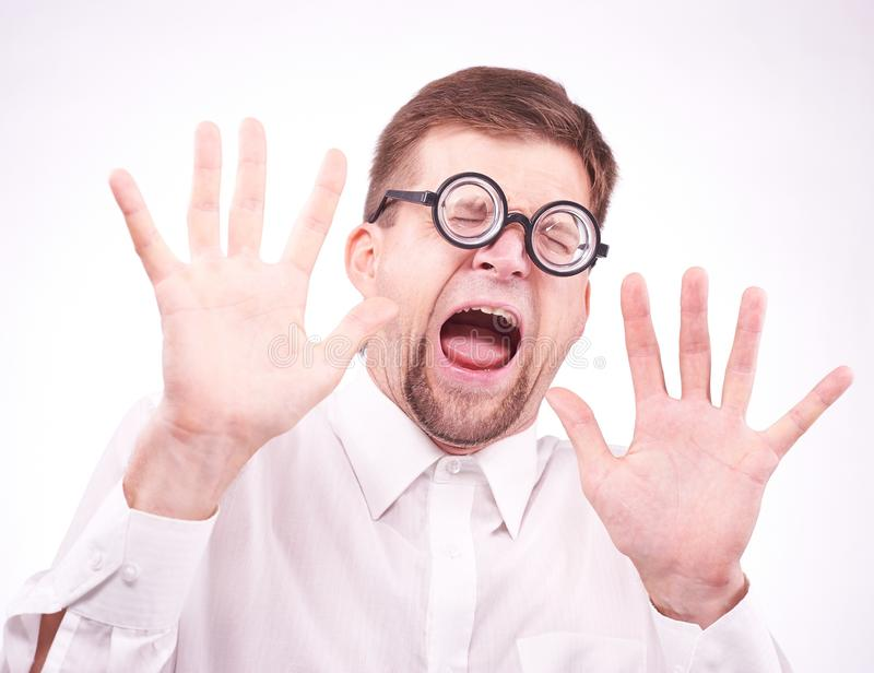 Afraid man in glasses. Portrait of an afraid man in glasses royalty free stock photo