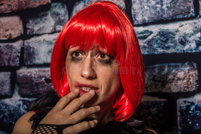 Afraid woman. Portrait of an afraid woman on the street crying on the wall during aggression royalty free stock images