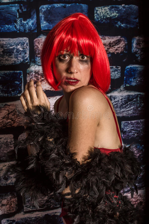 Afraid woman. Portrait of an afraid woman on the street crying on the wall during aggression royalty free stock photos