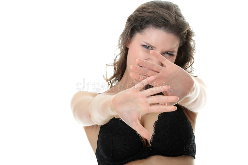 Afraid woman on the white. Afraid woman isolated on the white royalty free stock image