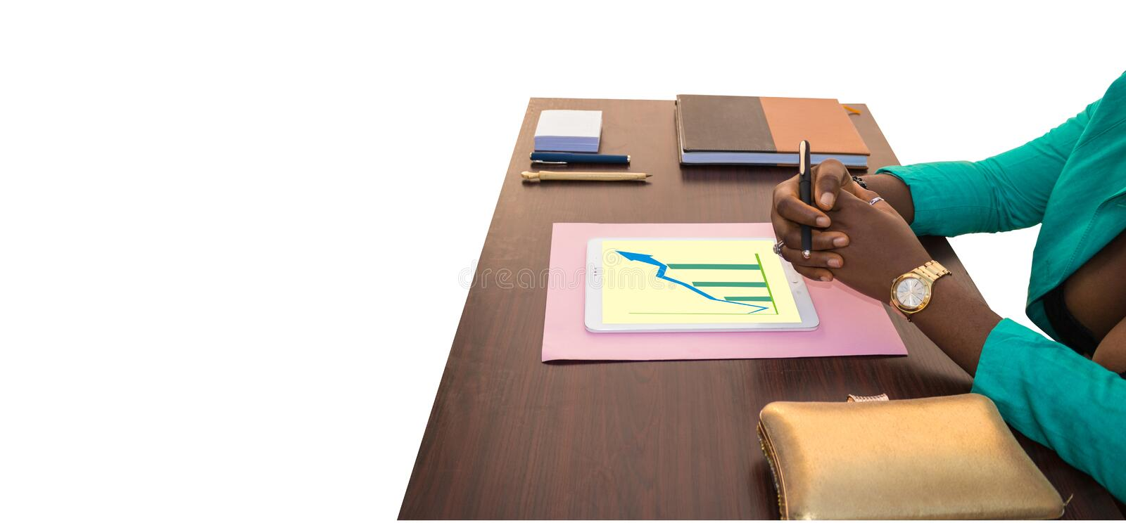 Good Business in Africa: Graph. African business woman sitting at her office table as she discusses business on a table with jotter, pen, tablet showing business royalty free stock photo