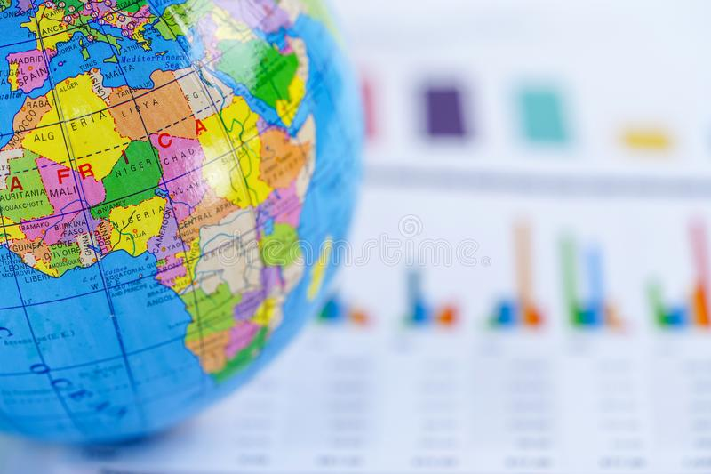 Africa Globe world map on chart graph paper. Finance, Account, Statistics, Investment, Analytic research data economy. Chart graph paper with globe world Africa royalty free stock photography