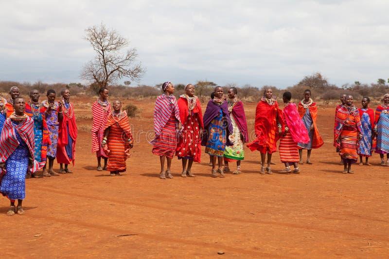 AFRICA, KENYA, MASAI MARA - JULY 2: Masai females dancing traditional jumps as cultural ceremony near to Masai Mara National Park royalty free stock image