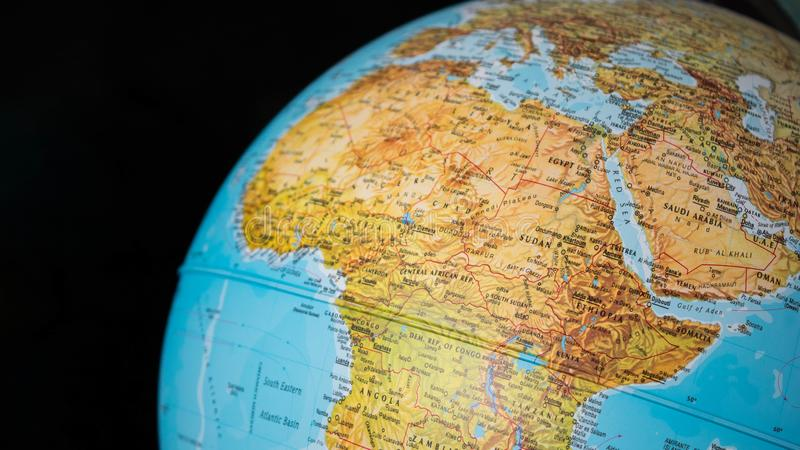 Africa and middle east map on a globe with a black background. Africa and middle east map on a globe with a black background stock photo