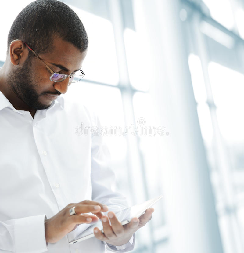African American Arabic person with pc tablet royalty free stock image