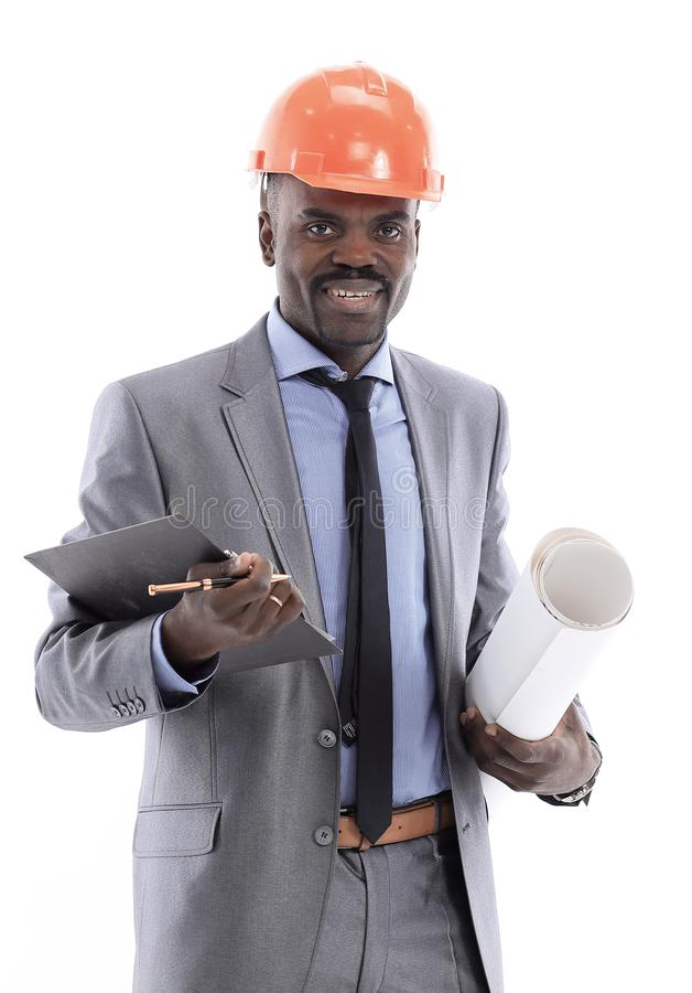 African American businessman in a helmet on a white background. African American architect isolated on white background - black people stock images