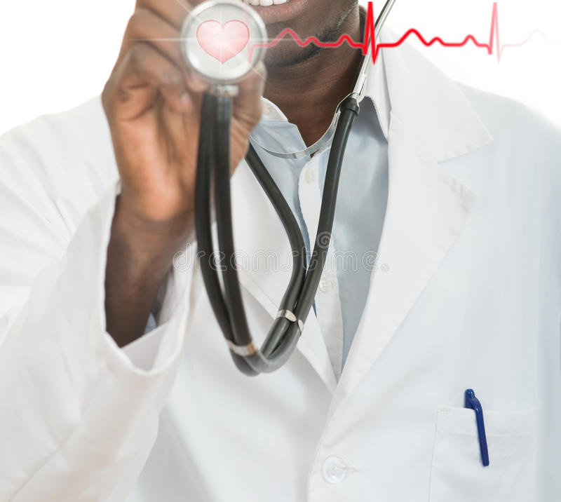 African-American black doctor man with stethoscope with hearth EKG.  royalty free stock photo