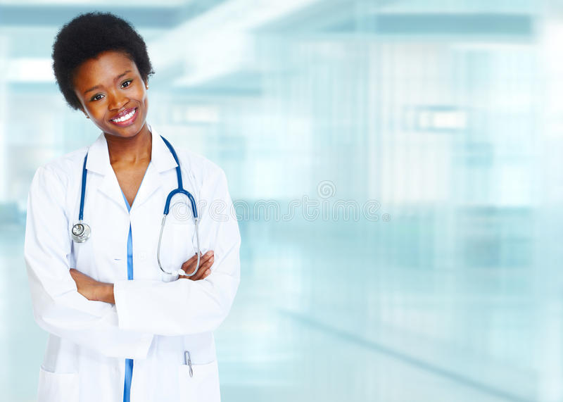 African-American black doctor woman. African-American black doctor woman over blue background royalty free stock photography