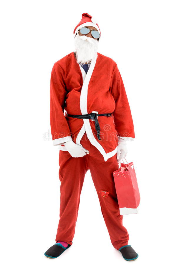 African American Black Thug Gangster Criminal Robber Santa. In red costume suit is holding a present bag stock photography
