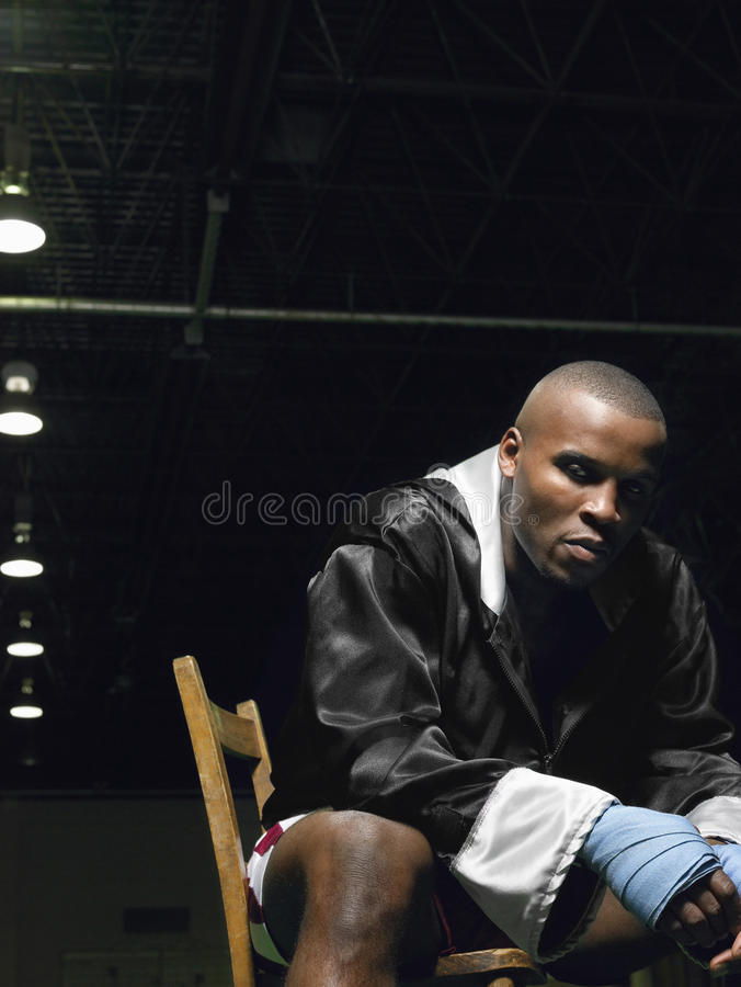 African American Boxer Sitting On Chair stock image