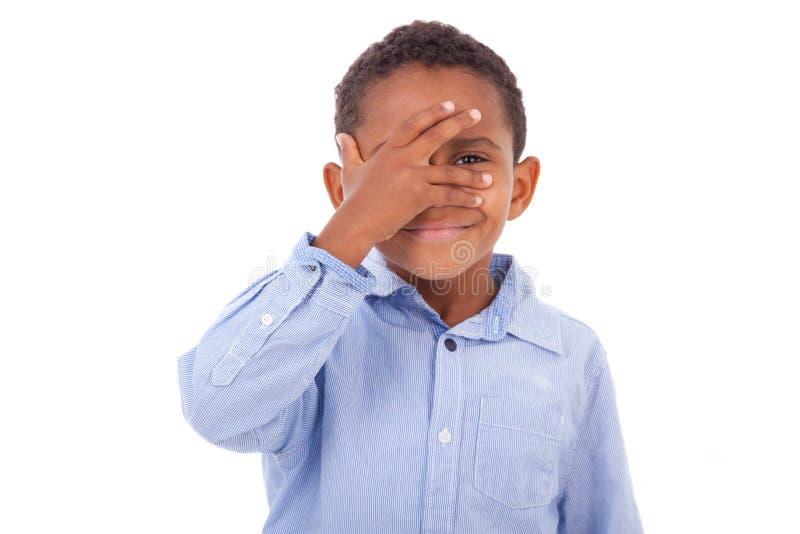 African American boy hiding eyes - Black people stock photos