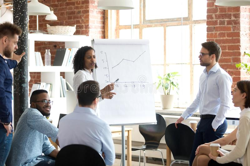 African American business coach speaking presentation at briefin stock photo