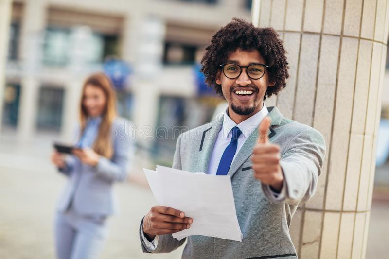 African american business executive giving thumb up stock images