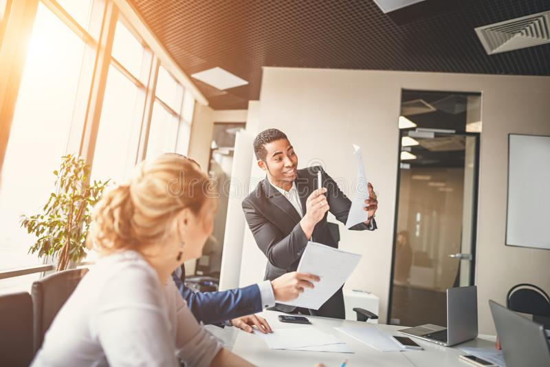 African-American business leader in working environment stock photo