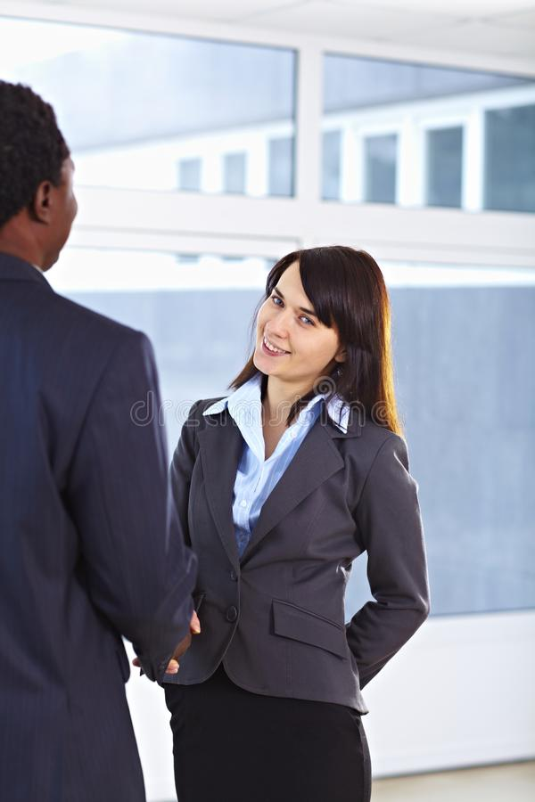 African American business man and caucasian woman royalty free stock images