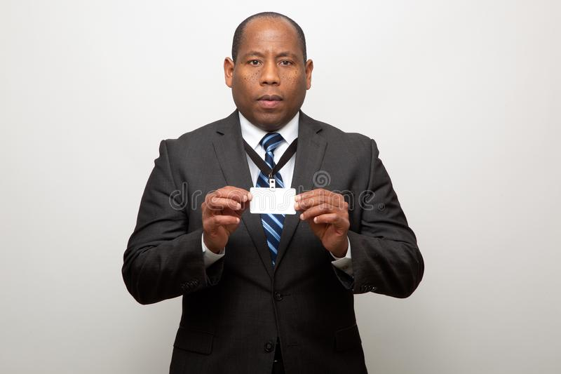 African American Business Man Showing ID Tag. African American Business Man Dressed in Suit Showing ID Tag royalty free stock photos