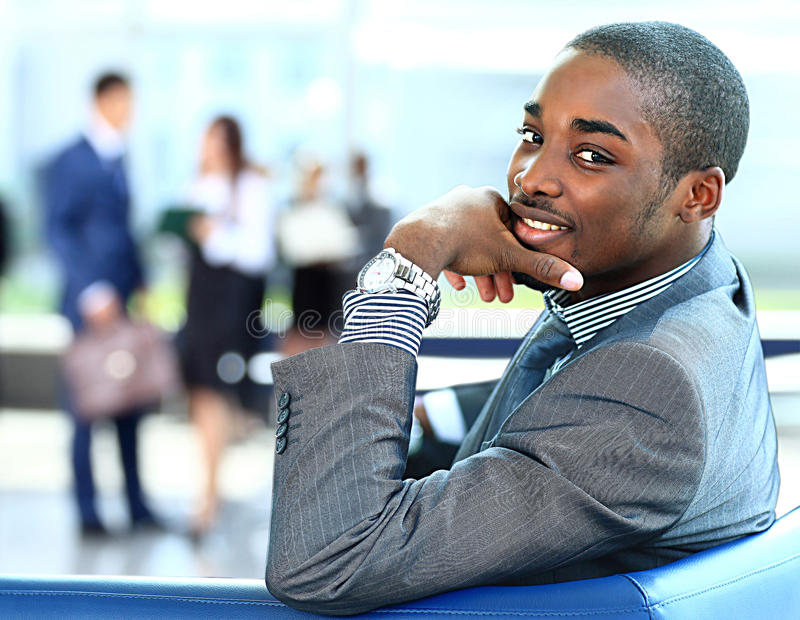 African American business man with executives working in background royalty free stock photography