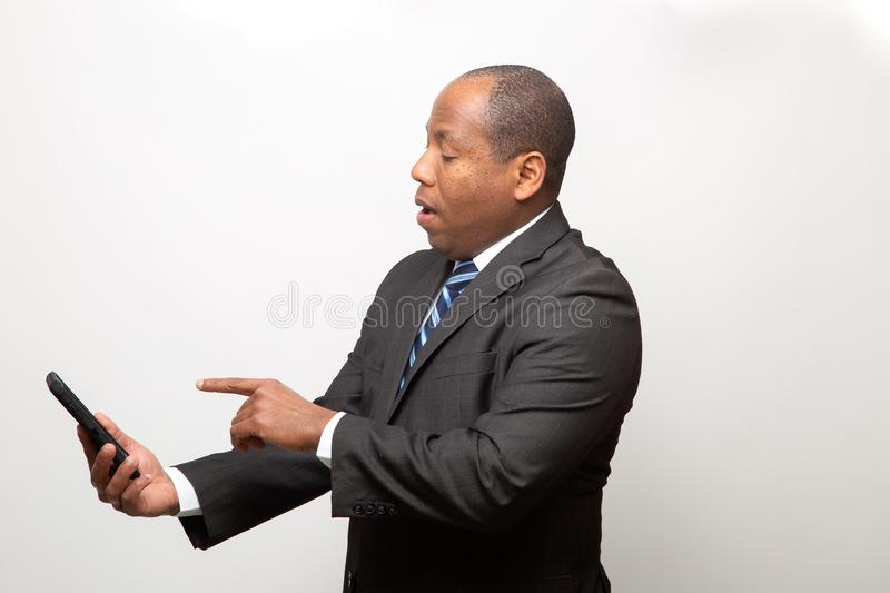 African American Business Man Having Fun With Cell Phone stock photos